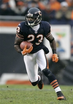 Chicago Bears kick returner Devin Hester returns a kick against the New Orleans Saints during the NFC Championship football football game, Sunday, Jan. 21, 2007, in Chicago. The Indianapolis Colts face the Chicago Bears in Super Bowl XLI in Miami on Sunday, Feb. 4, 2007. / AP Photo/Jeff Roberson