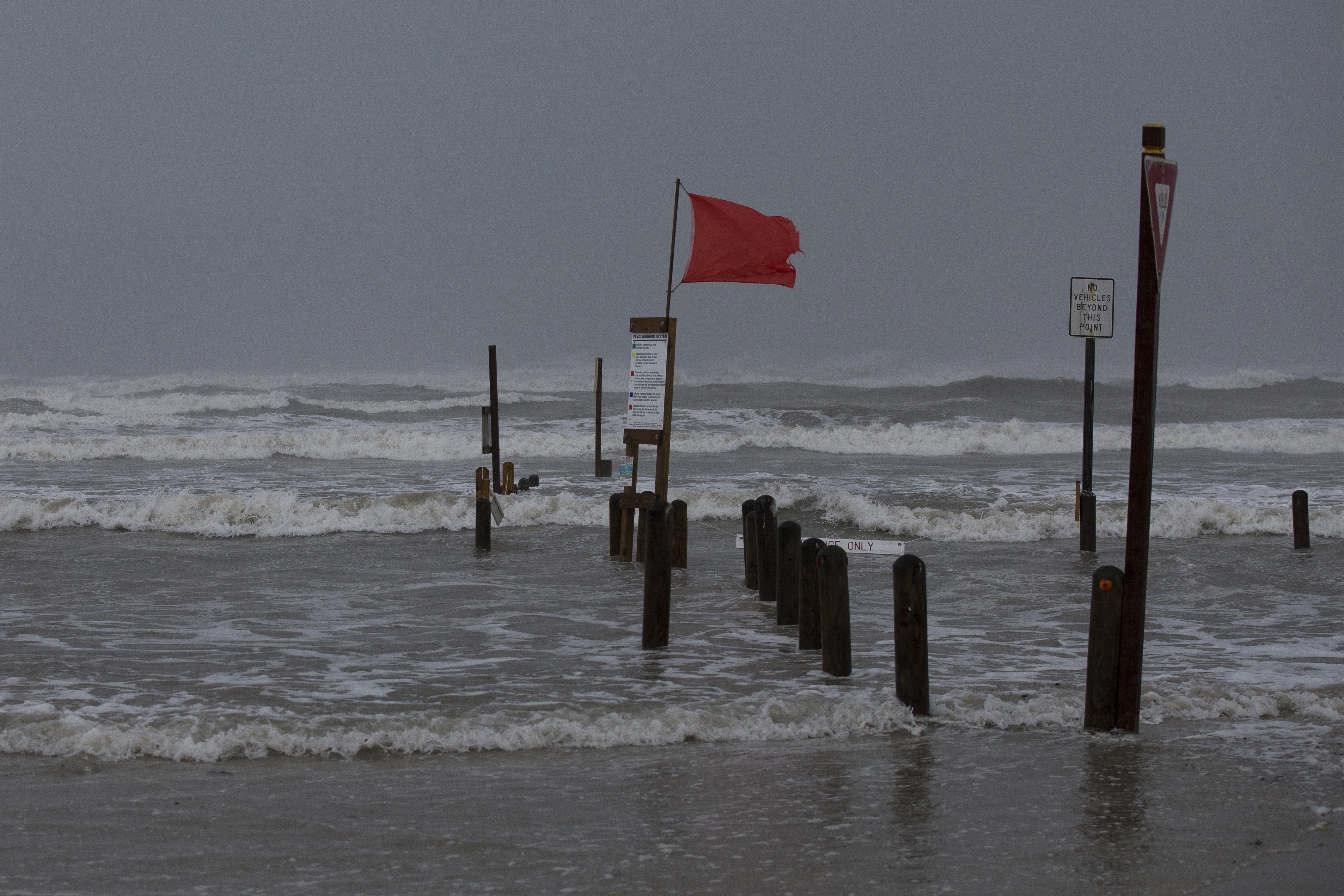 "Water rises at Bob Hall Pier in Corpus Christi, Texas as Hurricane Harvey approaches on Friday, Aug. 25, 2017.  The slow-moving hurricane could be the fiercest such storm to hit the United States in almost a dozen years. Forecasters labeled Harvey a ""life-threatening storm"" that posed a ""grave risk"" as millions of people braced for a prolonged battering. (Courtney Sacco/Corpus Christi Caller-Times via AP)"