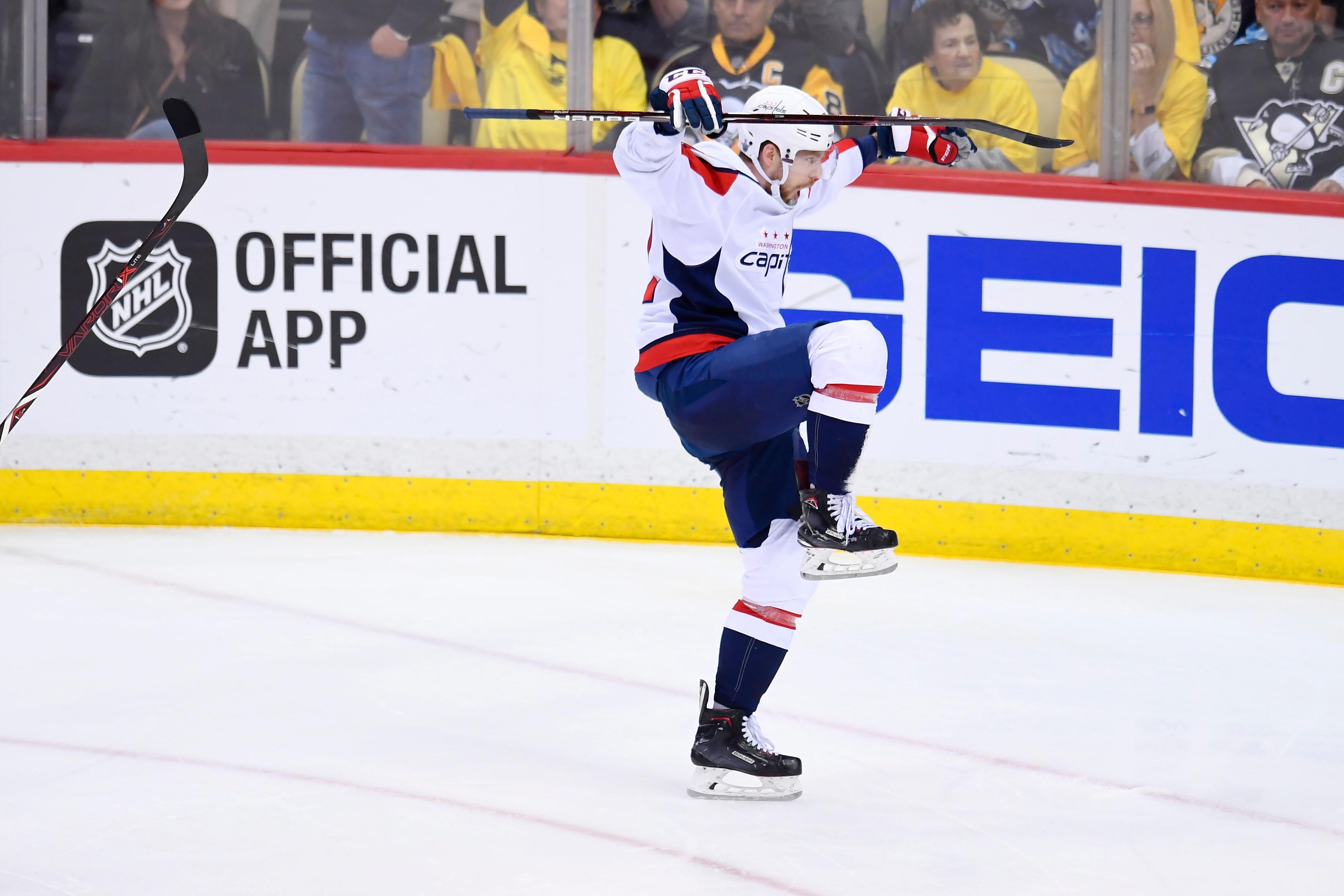 PITTSBURGH, PA - MAY 07: Washington Capitals Center Evgeny Kuznetsov (92) celebrates after scoring the game winning goal during the overtime period. The Washington Capitals went on win 2-1 in the overtime period against the Pittsburgh Penguins in Game Six of the Eastern Conference Second Round during the 2018 NHL Stanley Cup Playoffs on May 7, 2018, at PPG Paints Arena in Pittsburgh, PA. The Capitals won the series 4-2 and advance to the Conference Finals. (Photo by Jeanine Leech/Icon Sportswire via Getty Images)