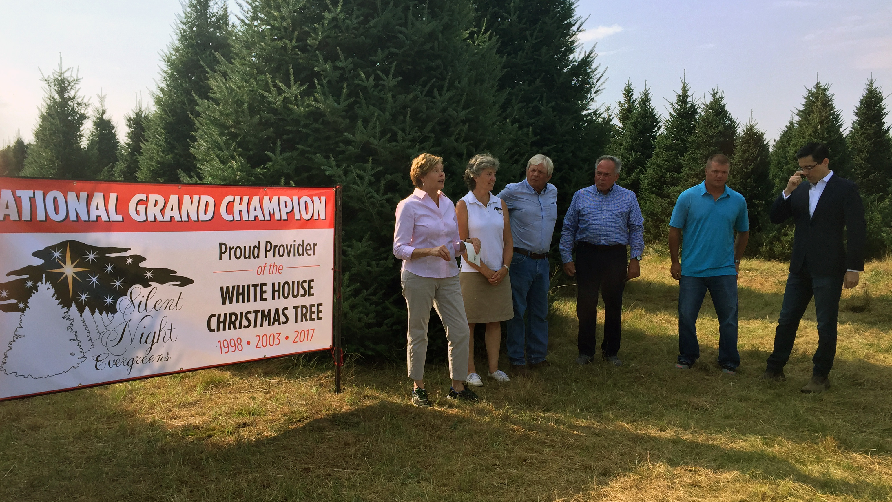 Representatives from the White House and Silent Night Evergreens begin the process of selecting the Christmas tree for the Blue Room, Sept. 25, 2017, at Hanauer's Tree Farms in Shawano County. (WLUK/Pafoua Yang)
