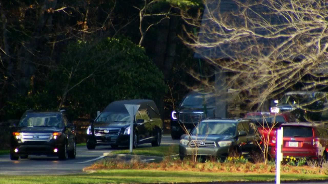 A hearse transporting Billy Graham's casket arrives at The Cove on Thursday, where family will hold a private service. (Photo credit: WLOS Staff)