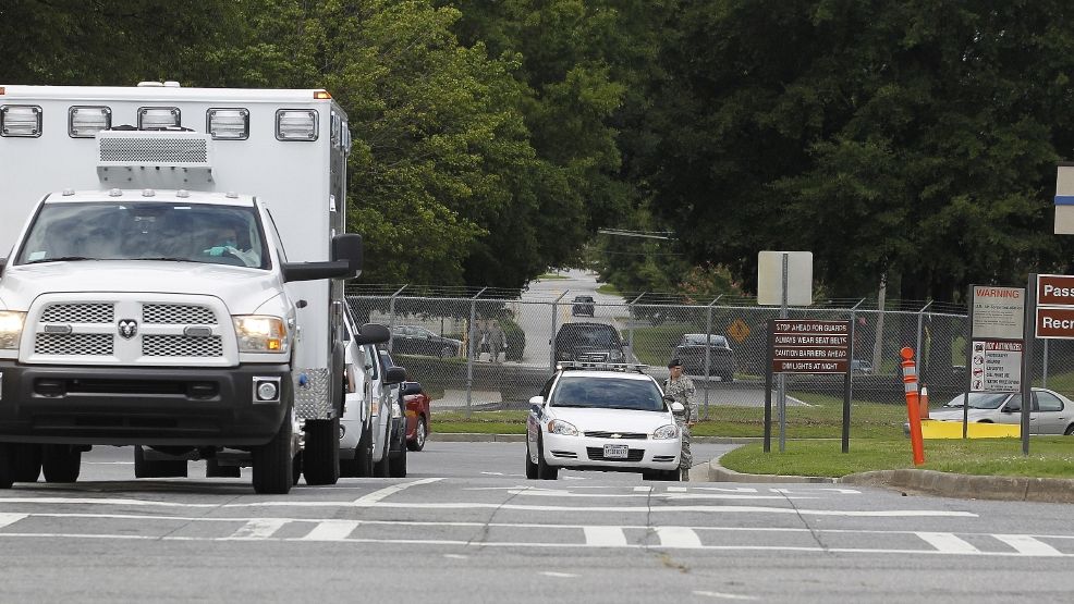 An ambulance departs Dobbins Air Reserve Base, Saturday, Aug. 2, 2014, in Marietta, Ga. Officials at Emory University Hospital in Atlanta expect an American that was infected with the Ebola virus to be transported today. (AP Photo/Mike Stewart)