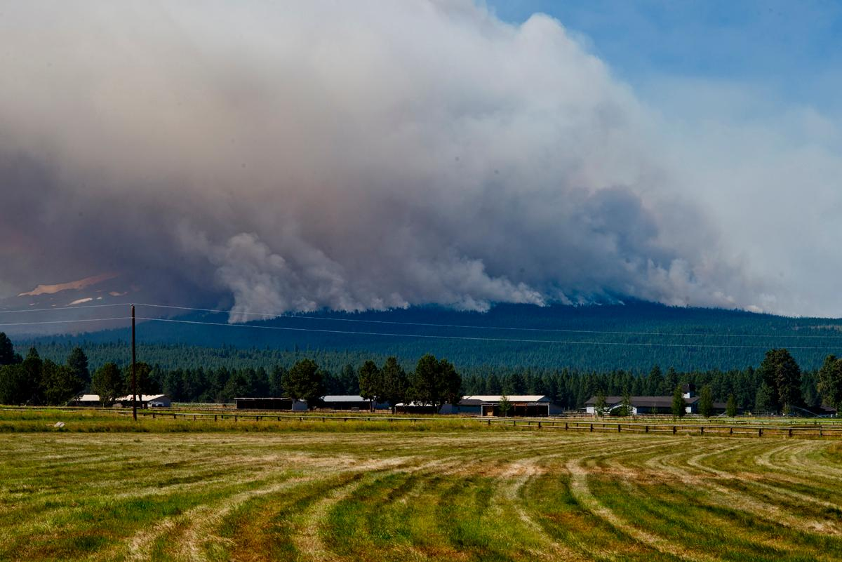 The Milli fire burns just southwest of the town of Sisters. The Three Sisters Mountains can be seen just below the smoke on the left. Taken at 11:30 am 18 August, 2017. Photo by Dan Morrison, Oregon News Lab