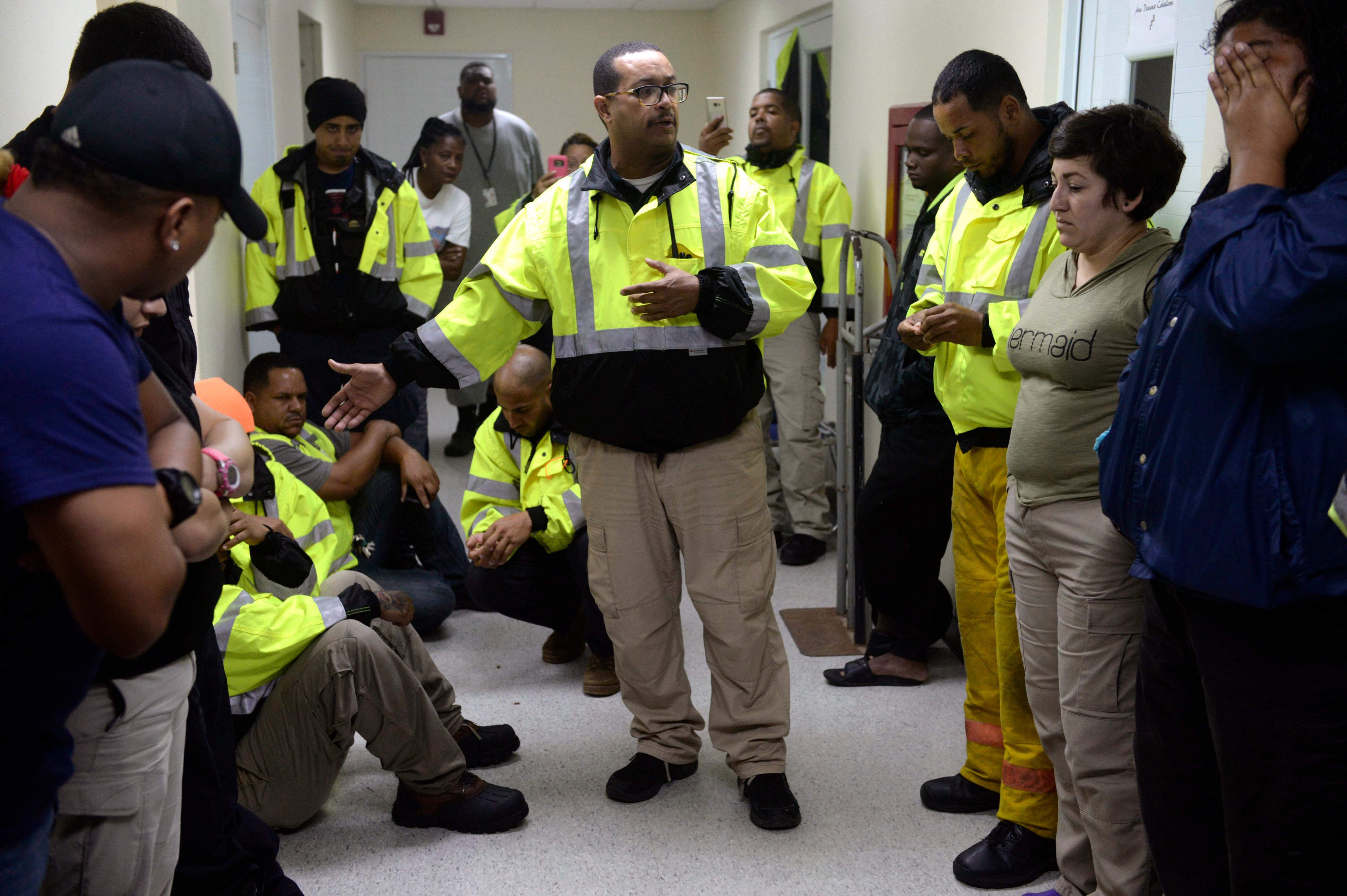 CORRECTS DAY OF WEEK TO WEDNESDAY FROM TUESDAY - Team leader Joey Rivera gives a speech while the team waits to assist in the aftermath of Hurricane Maria in Humacao, Puerto Rico, Wednesday, Sept. 20, 2017. (AP Photo/Carlos Giusti)