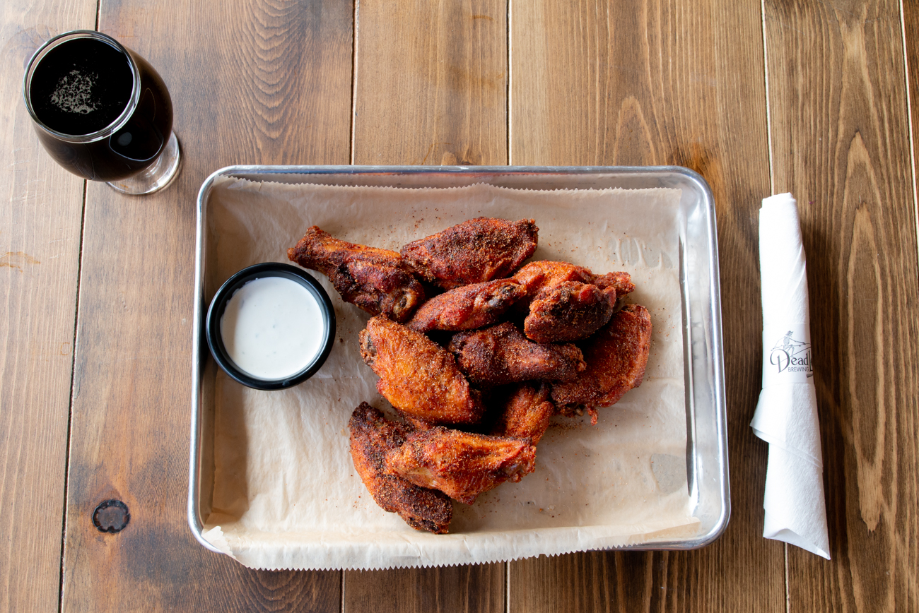 The chicken wings are made with all-natural and antibiotic-free chicken raised right here in Ohio. They're marinated for 24 hours, deep fried or smoked, and then flavored in one of over a dozen house-made sauces and dry rubs. / Image: Elizabeth Lowry // Published: 11.5.19