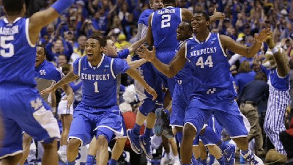 Kentucky  players celebrate after an NCAA Midwest Regional final college basketball tournament game against Michigan Sunday, March 30, 2014, in Indianapolis. Kentucky won 75-72 to advance to the Final Four.(AP Photo/Michael Conroy)