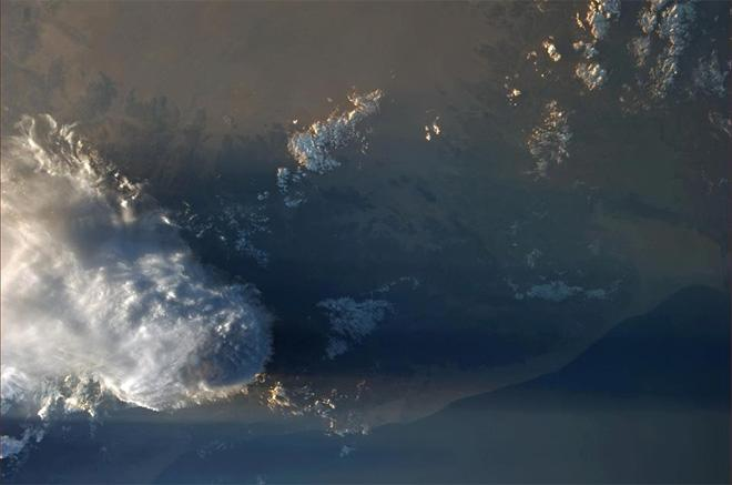 A storm casts a shadow over hundreds of miles in the desert (Photo & Caption: Luca Parmitano, NASA)