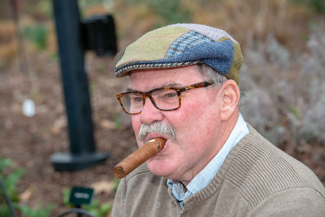 Tim Tighe with a Brick Cigar{ }/ Image: Joe Simon // Published: 4.5.19