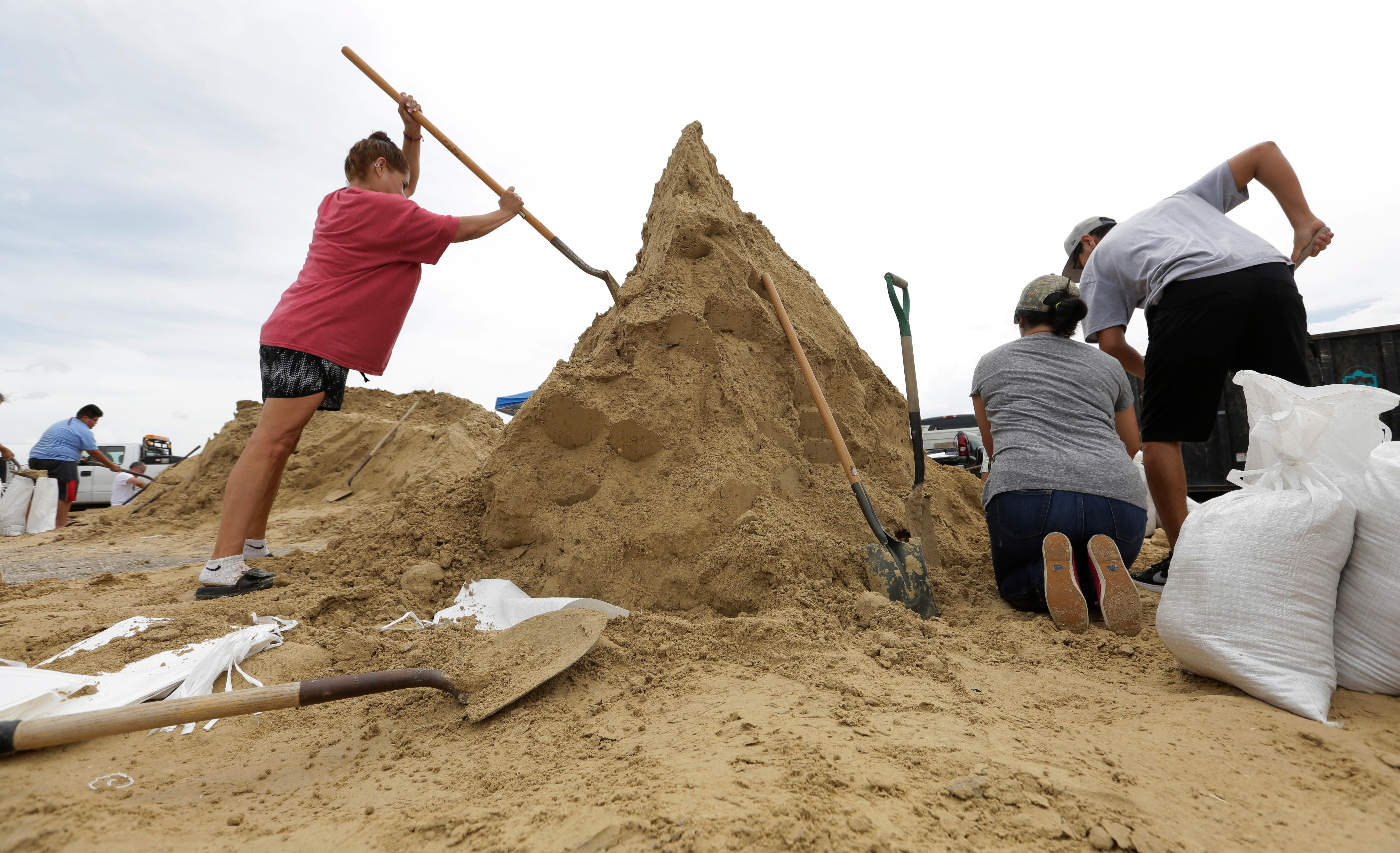 Residents fill sand bags as they prepare for Hurricane Harvey, Thursday, Aug. 24, 2017, in Corpus Christi, Texas.  Two counties have ordered mandatory evacuations as Hurricane Harvey gathers strength as it drifts toward the Texas Gulf Coast.   (AP Photo/Eric Gay)