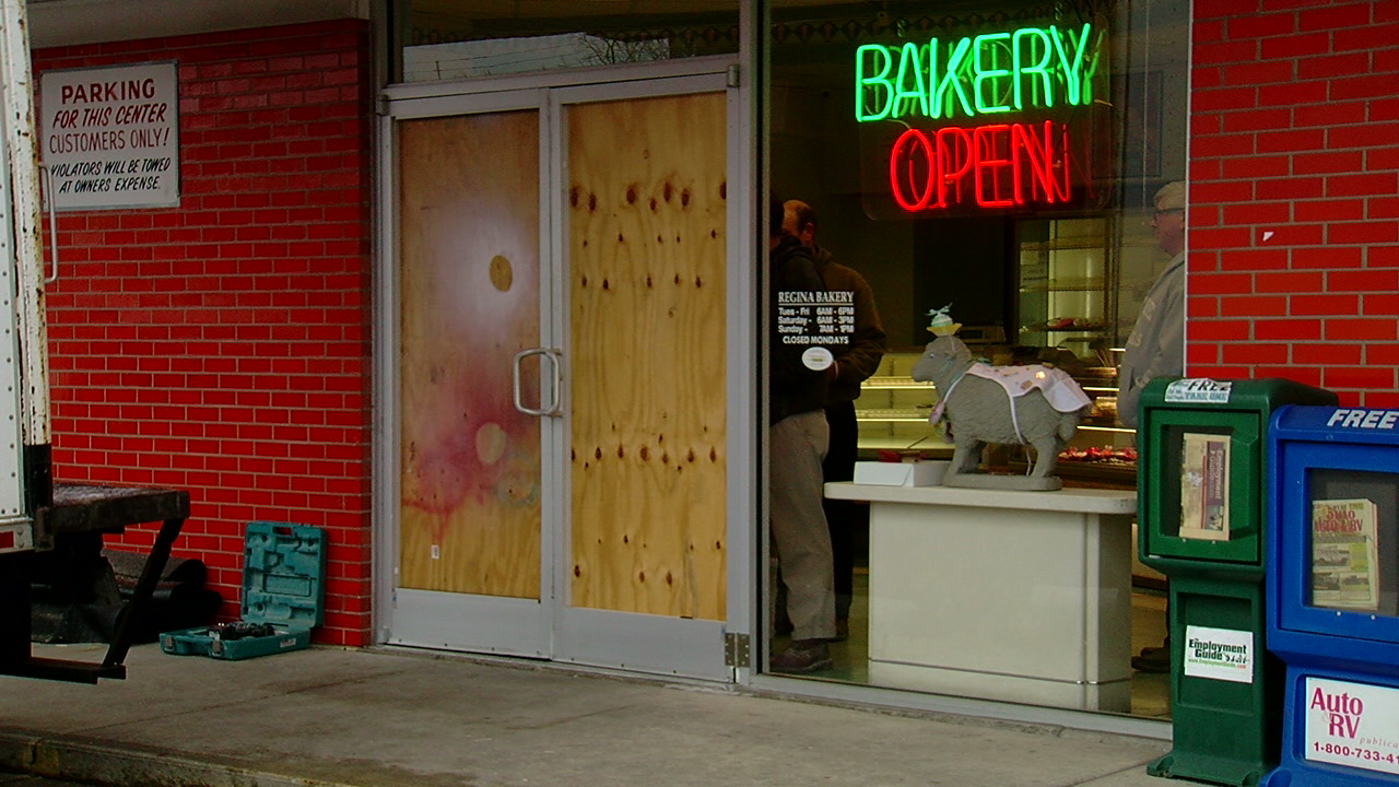 The Regina Bakery in Cheviot is partly boarded up after a car came through the front & Car hits front doors of Cheviot bakery | WKRC