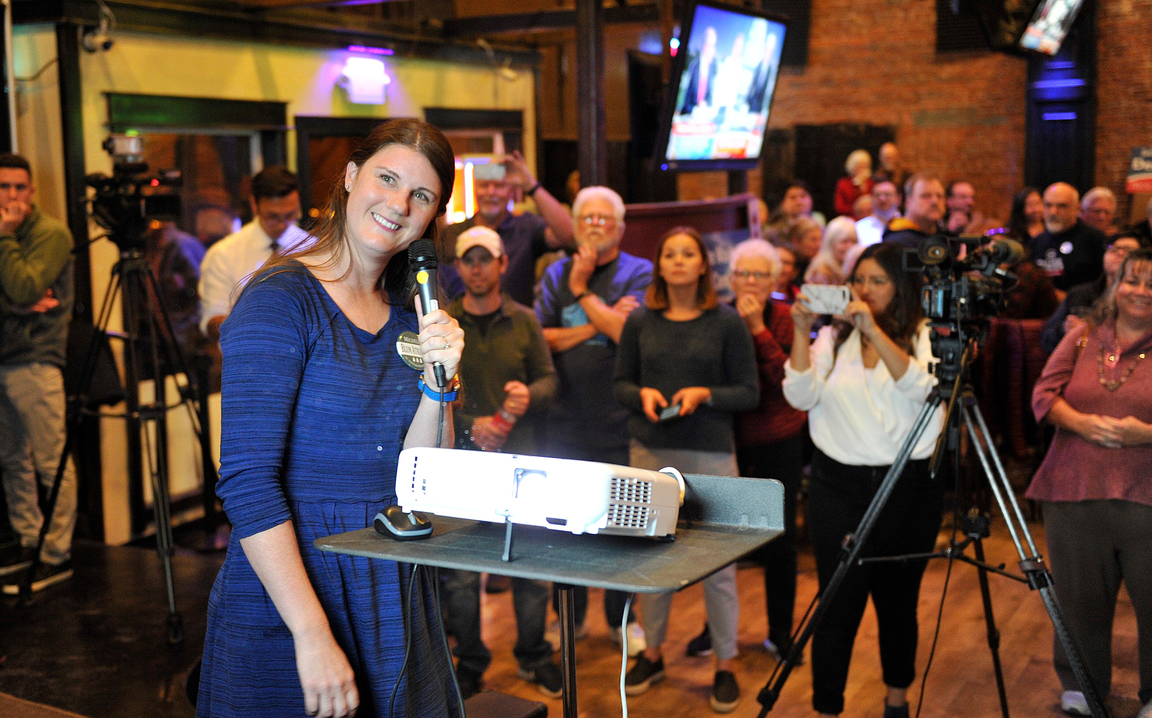 Michelle Blum Atkinson reacts after reading the first round of ballot for Oregon State Representative District 6 at the Grape Street Bar and Grill in Medford. Jamie Lusch / Mail Tribune