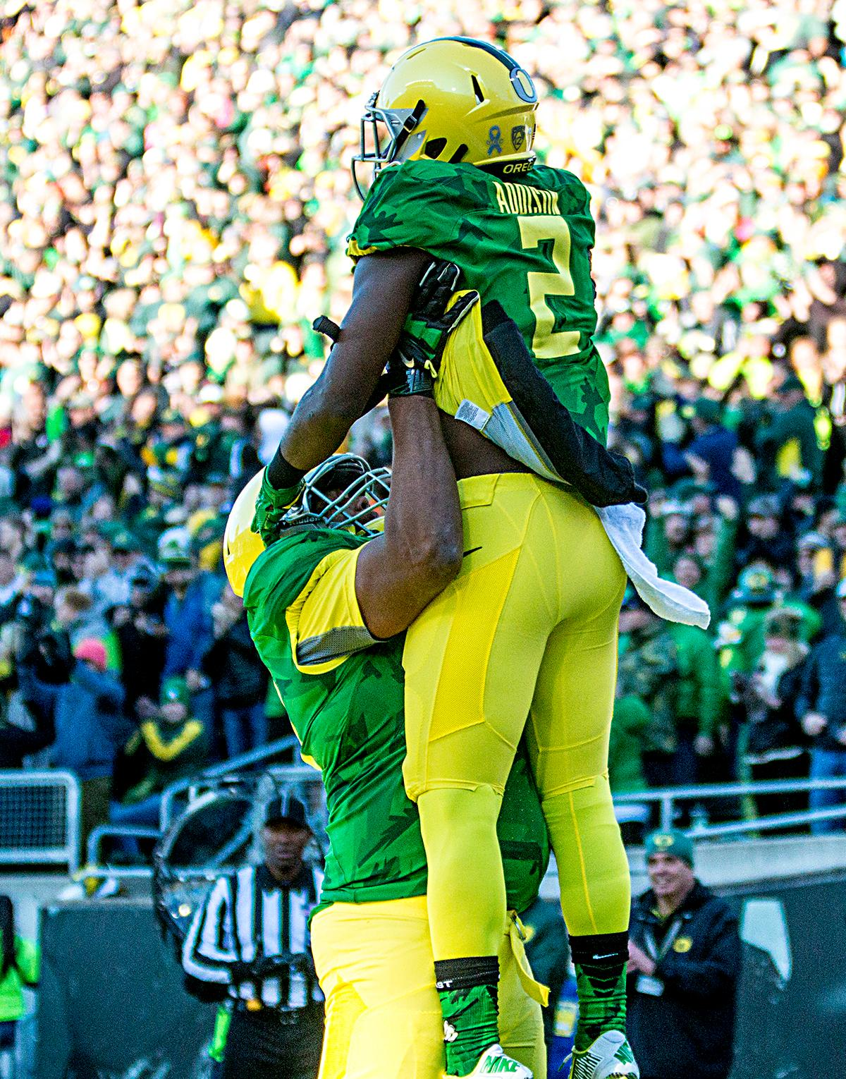 Oregon Ducks Braylon Addison (#2) is congratulated by his teammates after scoring against the Oregon State Beavers in the Civil War game in Autzen Stadium. At the half the Ducks led the Beavers 31 - 7. Photo by Katie Pietzold, Oregon News Lab