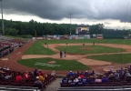 Teams take the field for day two of the WIAA state baseball tournament after a rain delay of more than five hours at Fox Cities Stadium in Grand Chute, June 18, 2014. (WLUK/Laura Smith)