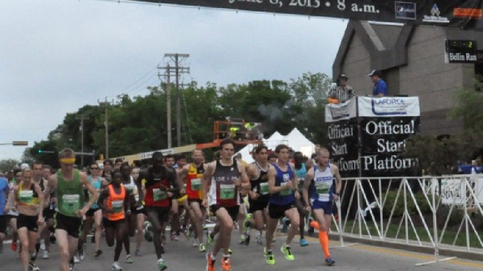 Runners take off at the starting line of the Bellin Run, June 8, 2013, in Green Bay. (WLUK/Emily Deem)