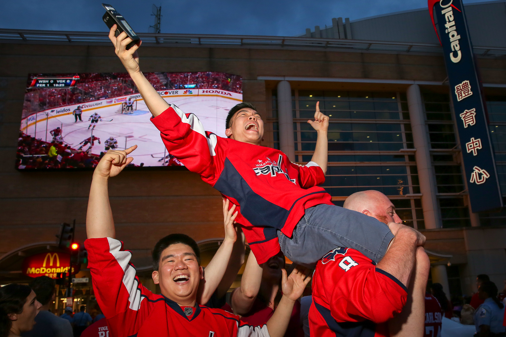 Caps fans celebrate a win during the Stanley Cup finals in June.{ }(Amanda Andrade-Rhoades/DC Refined)