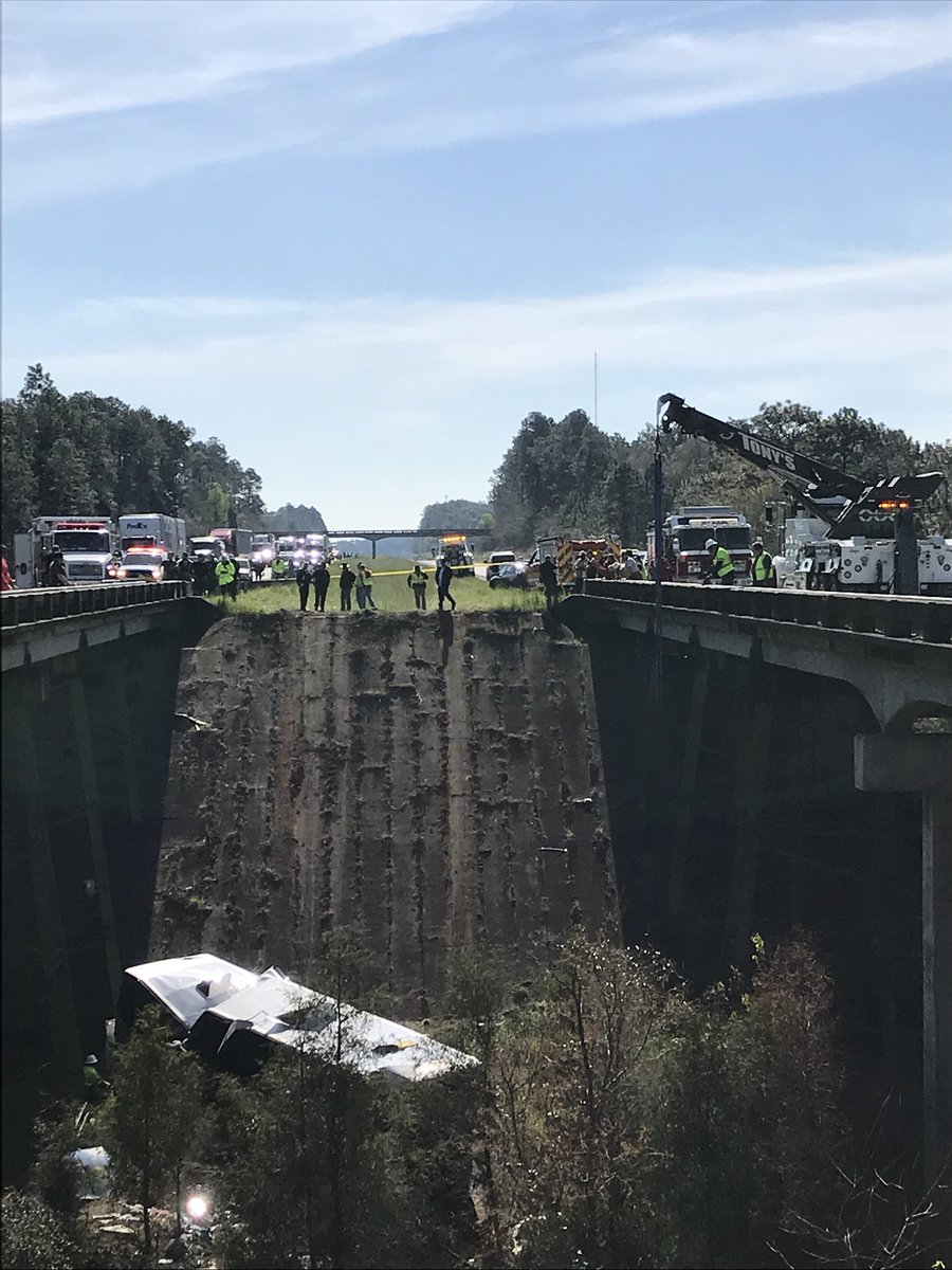Tour bus carrying 52 plunges down Alabama ravine. (WPMI)