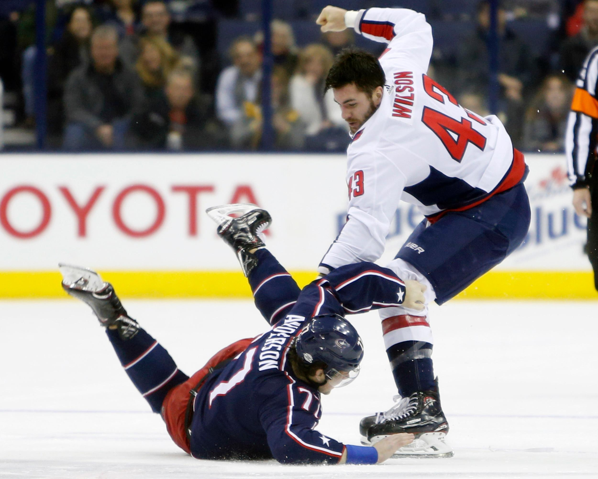 Washington Capitals' Tom Wilson, top, knocks Columbus Blue Jackets' Josh Anderson to the ice during the first period of an NHL hockey game Tuesday, Feb. 6, 2018, in Columbus, Ohio. (AP Photo/Jay LaPrete)