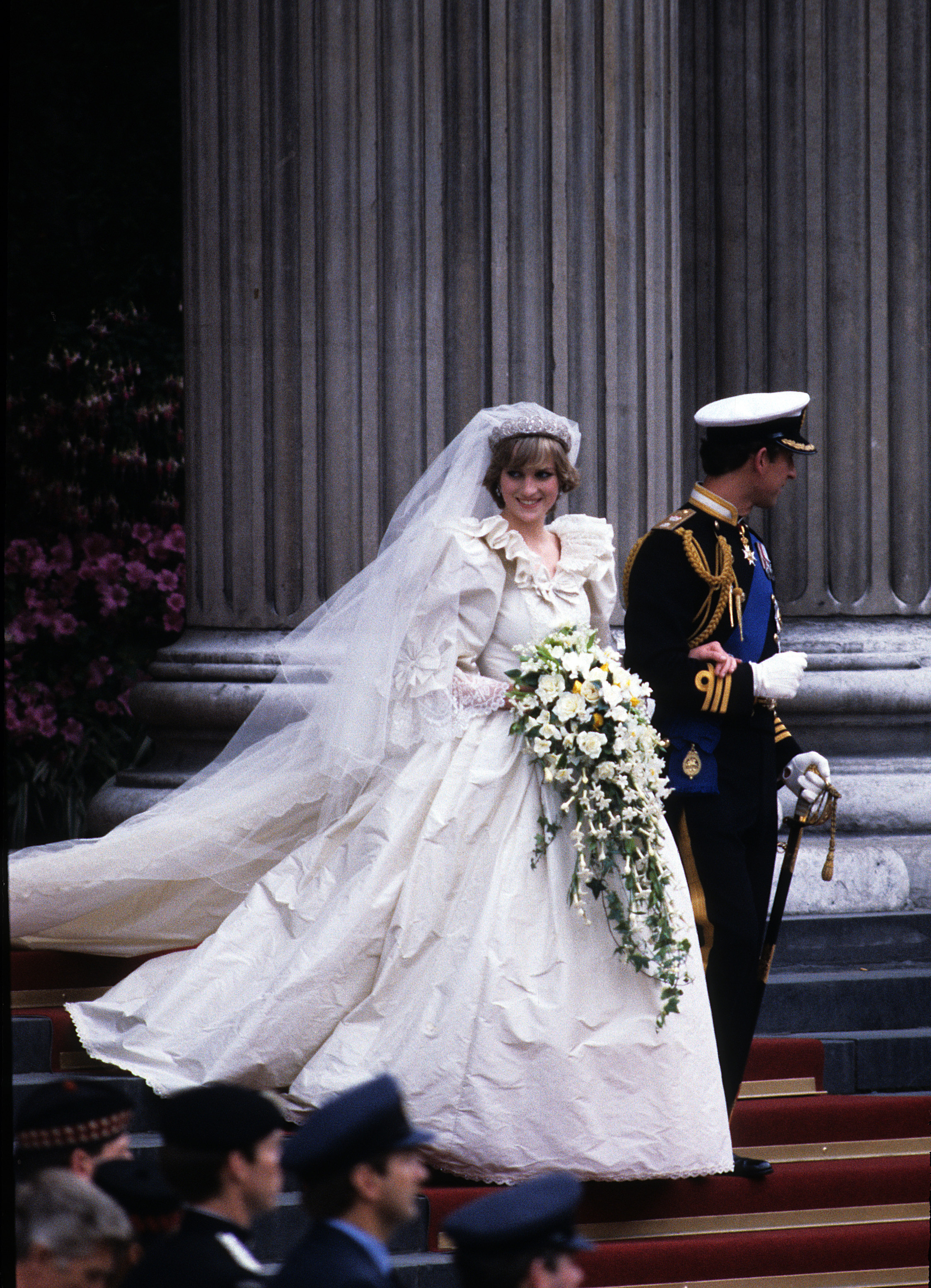 File Photo*** The designers behind Princess Diana's wedding dress are putting a host of iconic outfits belonging to the late royal under the hammer. David and Elizabeth Emanuel designed the fairytale princess gown Diana wore to marry Prince Charles in 1981, and helped the shy nursery school teacher become the most glamorous and beloved member of British royal family. Included in the sale is the black taffeta Emanuel dress worn by Diana on her first appearance as the Prince of Wales' fiance, as well as original sketches of her wedding dress and the chiffon blouse Diana wore for her engagement portrait by Lord Snowdon. The lots will be open to bidders in London on 8 June (10). London, England - 13.04.10  Diana, Princess of Wales, wearing an Emanuel wedding dress,  and Prince Charles, Prince of Wales leave St. Paul's Cathedral following their wedding on 29 July 1981.  Featuring: ***File Photo*** Where: London, United Kingdom When: 12 Apr 2010 Credit: WENN  **Not available for publication in France**