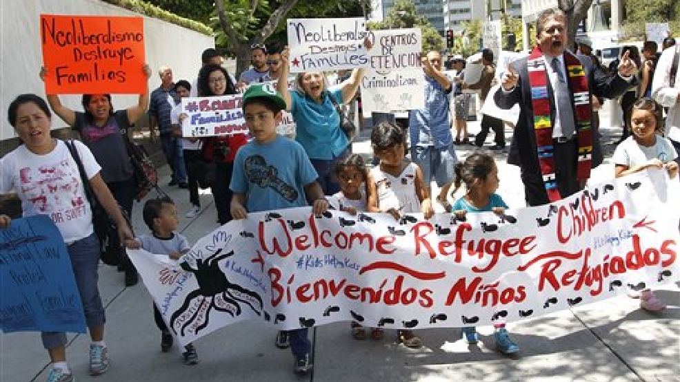 In this July 7, 2014 file photo, immigrant families and children's advocates rally in response to President Barack Obama's statement on the crisis of unaccompanied children and families illegally entering the United States, outside the Los Angeles Federal building. Tackling what he has called a humanitarian crisis, Obama on Tuesday, July 8, 2014 asked Congress for $3.7 billion to cope with a tide of minors from Central America who are illegally crossing the U.S. border, straining immigration resources and causing a political firestorm in Washington. (AP Photo/Nick Ut, File)