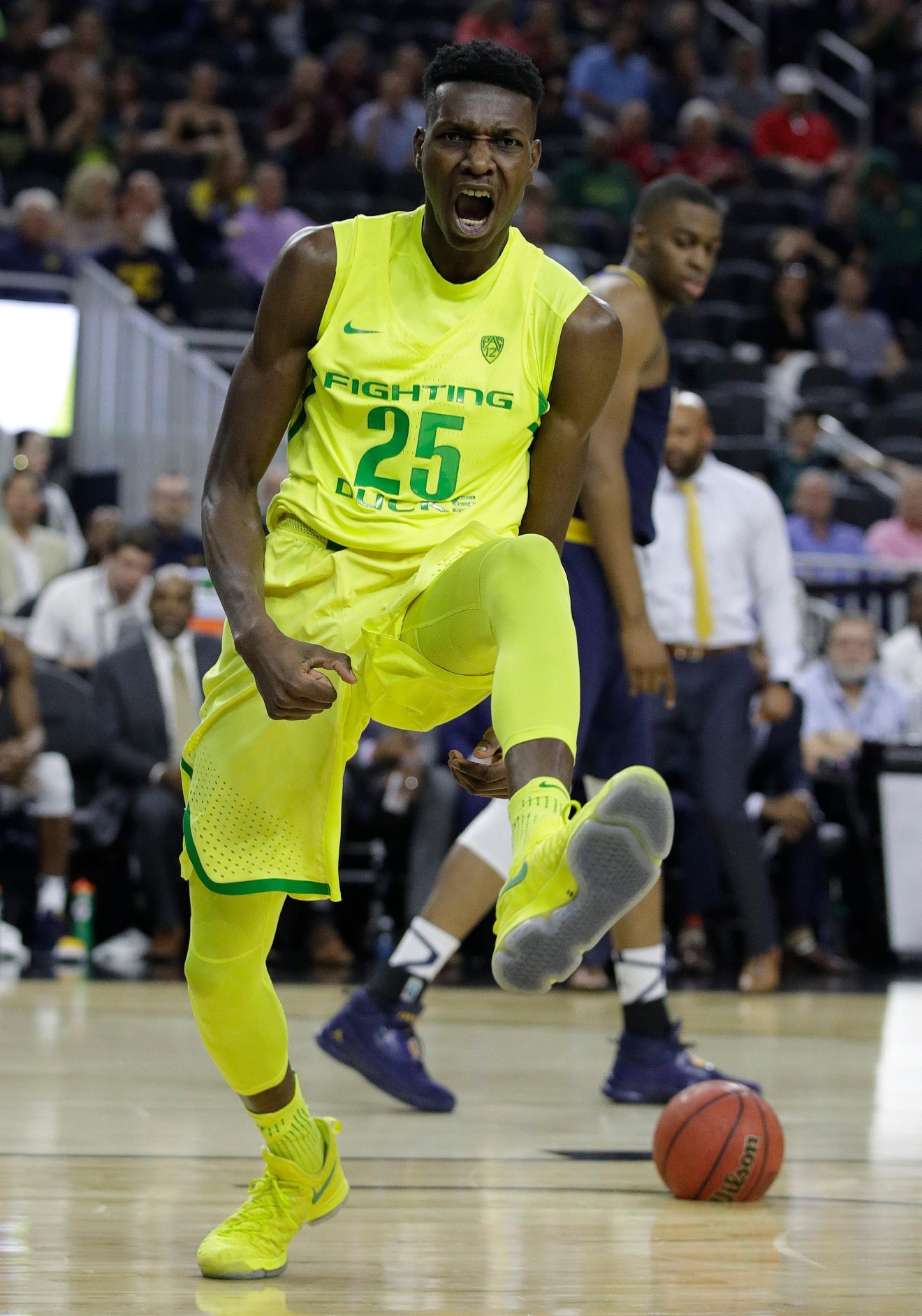 Oregon's Chris Boucher reacts after scoring against California during the first half of an NCAA college basketball game in the semifinals of the Pac-12 tournament Friday, March 10, 2017, in Las Vegas. (AP Photo/John Locher)