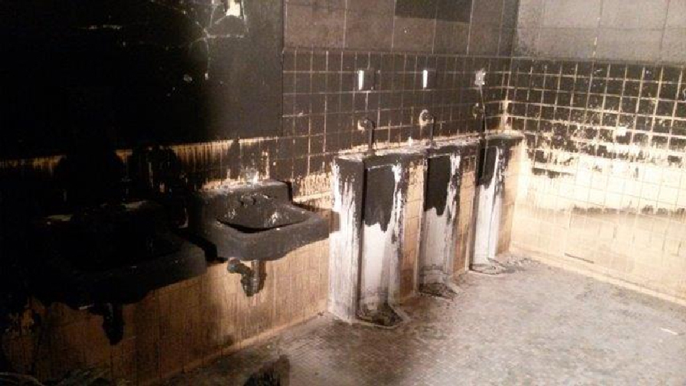 A look at the damage to the men's bathroom at Oconto High School on Friday, April 18, 2014. (Courtesy: Paul Davis National)