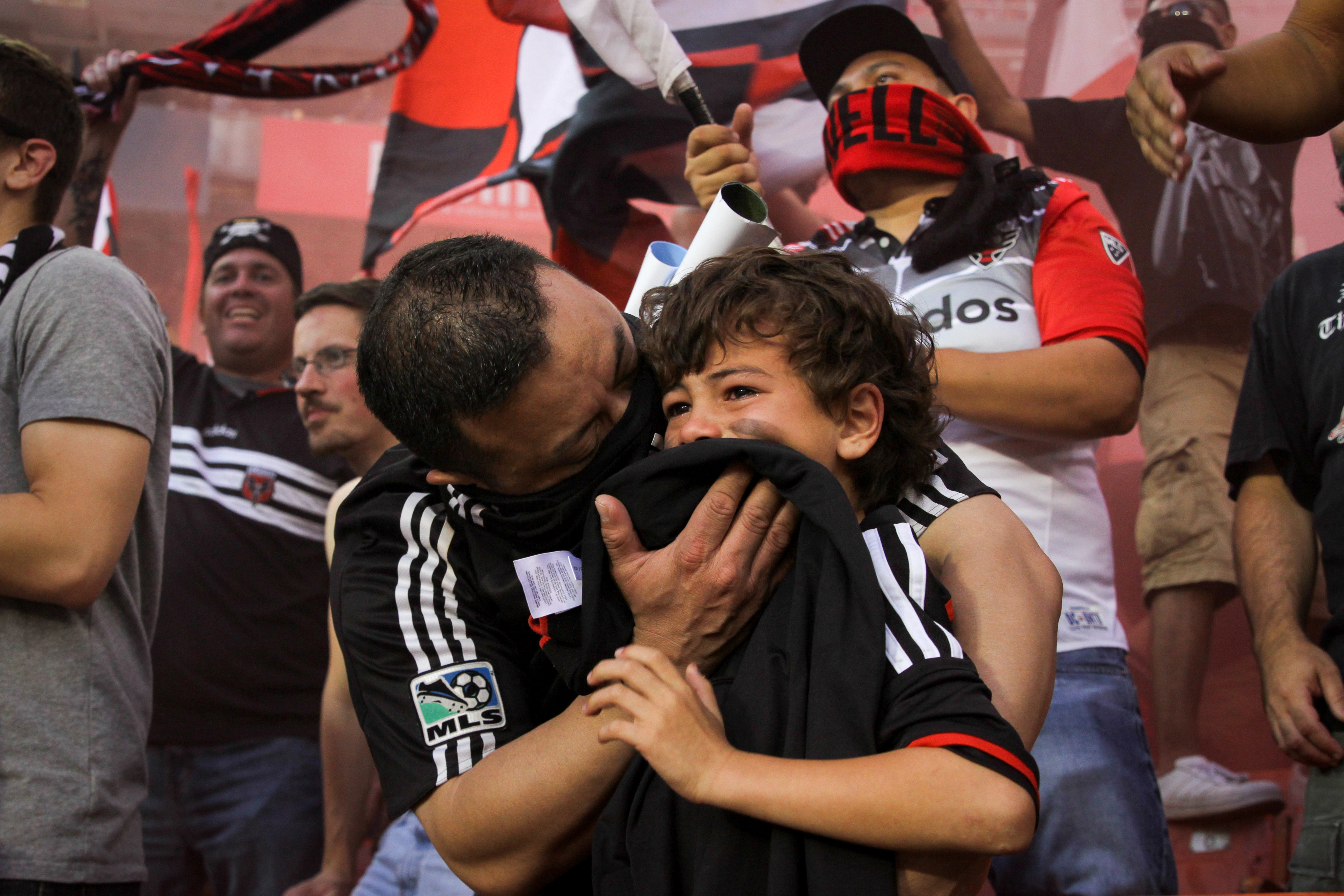 November, 2017. A man protects his son's face during DC United's final game at RFK Stadium.{&amp;nbsp;} (Amanda Andrade-Rhoades/DC Refined)<p></p>