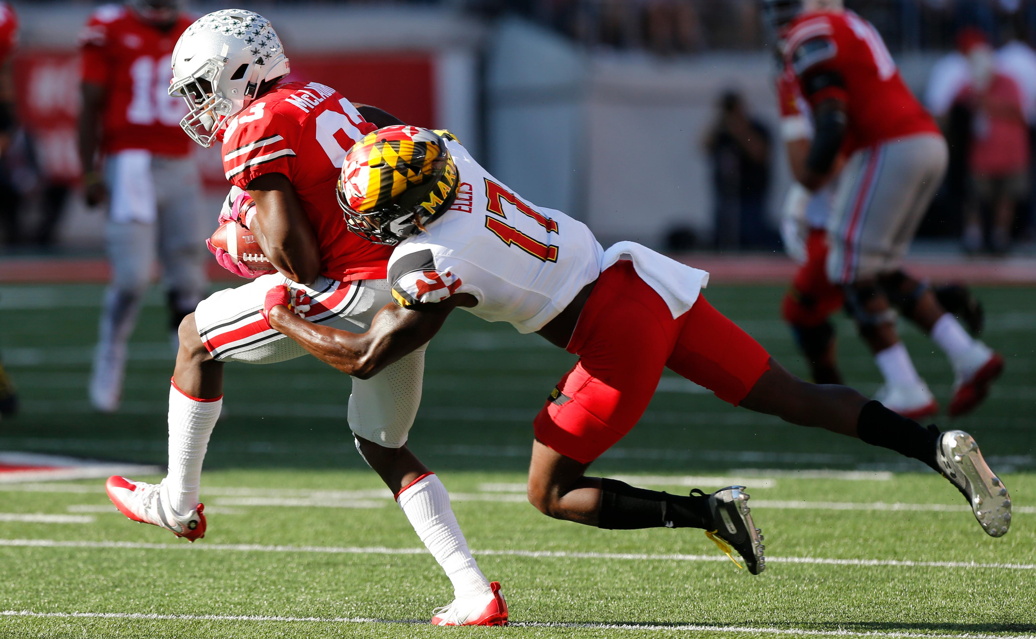 Maryland defensive back Tino Ellis, right, tackles Ohio State receiver Terry McLaurin during the first half of an NCAA college football game Saturday, Oct. 7, 2017, in Columbus, Ohio. (AP Photo/Jay LaPrete)