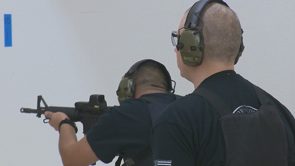 A new Green Bay police officer trains at the shooting range.
