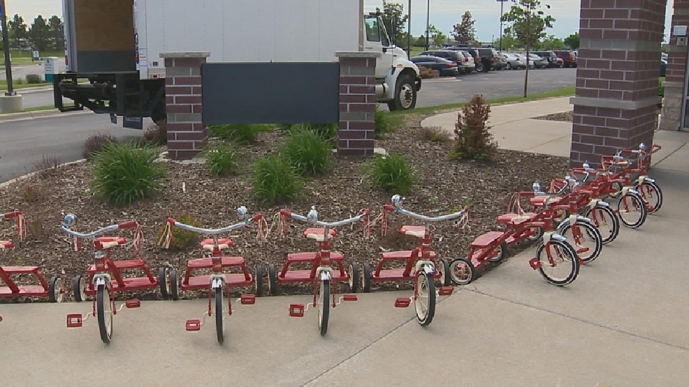 Festival Foods donated these ten new tricycles to the Salvation Army of Brown County, Wednesday, June 4, 2014. (WLUK)