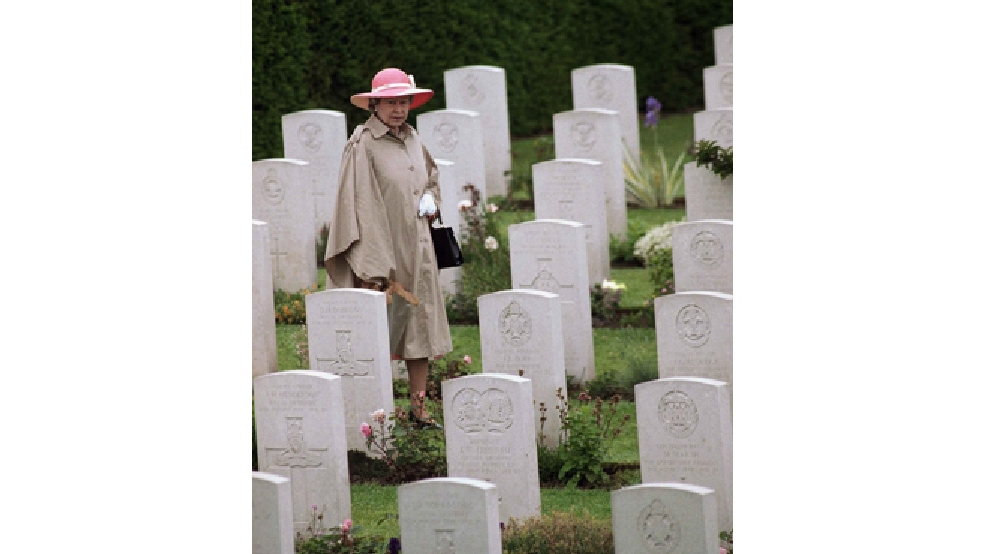 In this Monday, June 6, 1994 file photo, Queen Elizabeth II is seen walking through the British Military Cemetery in Bayeux, France, during ceremonies honoring veterans and war dead on the 50th anniversary of D-Day. (AP Photo/Laurent Rebours, File)