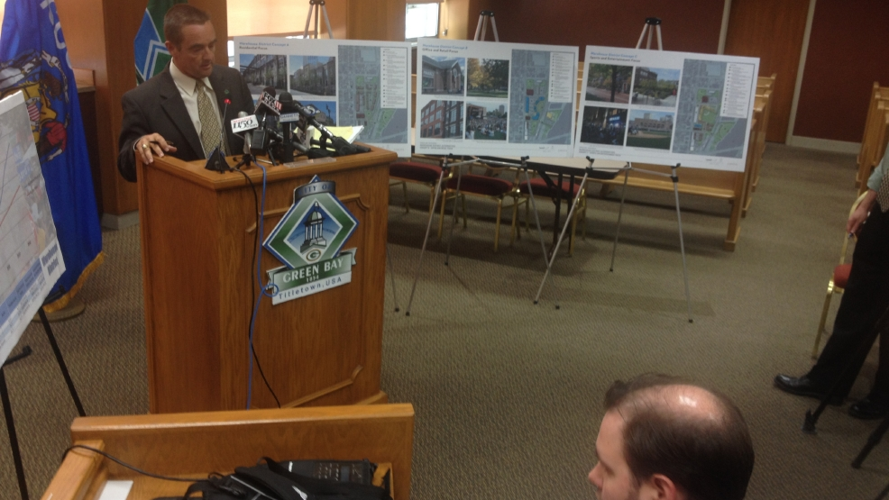 Green Bay Mayor Jim Schmitt pitches alternative ideas for the vacant downtown Larsen-Green site in a June 12, 2014 news conference. Walmart wants to build a 154,000 sq. ft. supercenter. (WLUK/Bill Miston)