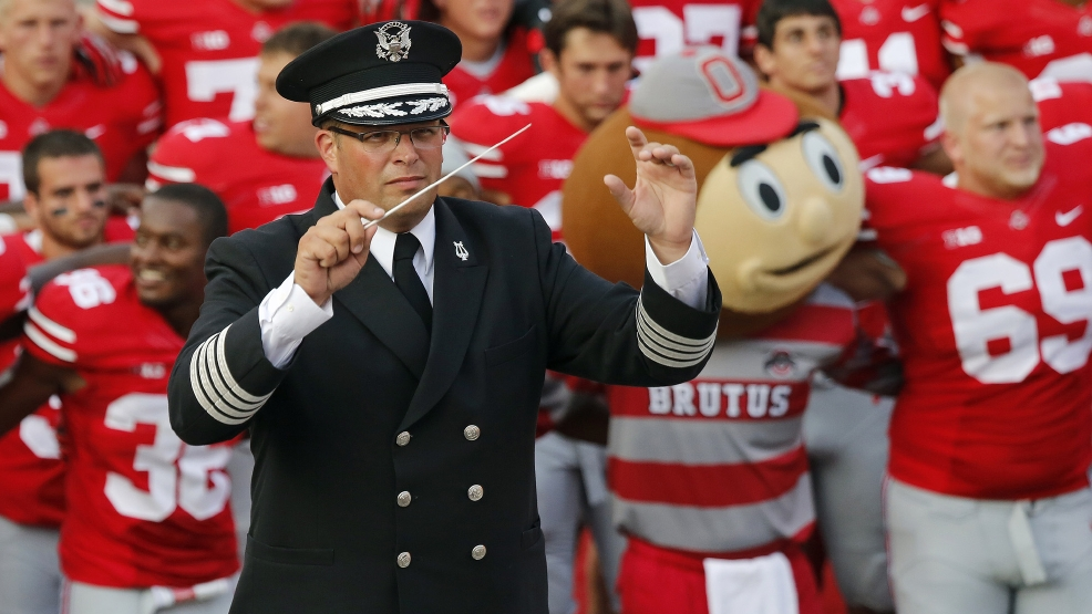 "In this Sept. 7, 2013 file photo, Ohio State University marching band director Jonathan Waters leads the band in ""Carmen Ohio"" following a NCAA football game against San Diego State at Ohio Stadium in Columbus, Ohio. Ohio State officials say there is no recent record of campus police attending an annual ritual where marching band members entered Ohio Stadium in their underwear. The Midnight Ramps were cited in an investigation into the band's ""sexualized culture"" that resulted in Waters' July 24 firing. (AP Photo/The Columbus Dispatch, Adam Cairns, File)"