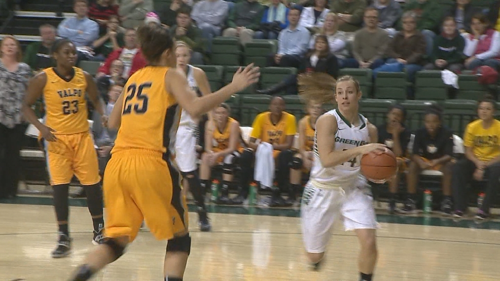 Megan Lukan (14) drives and passes against Valparaiso during a Horizon League tournament game on Wednesday, March 12, 2014. (WLUK/Nate Garot)