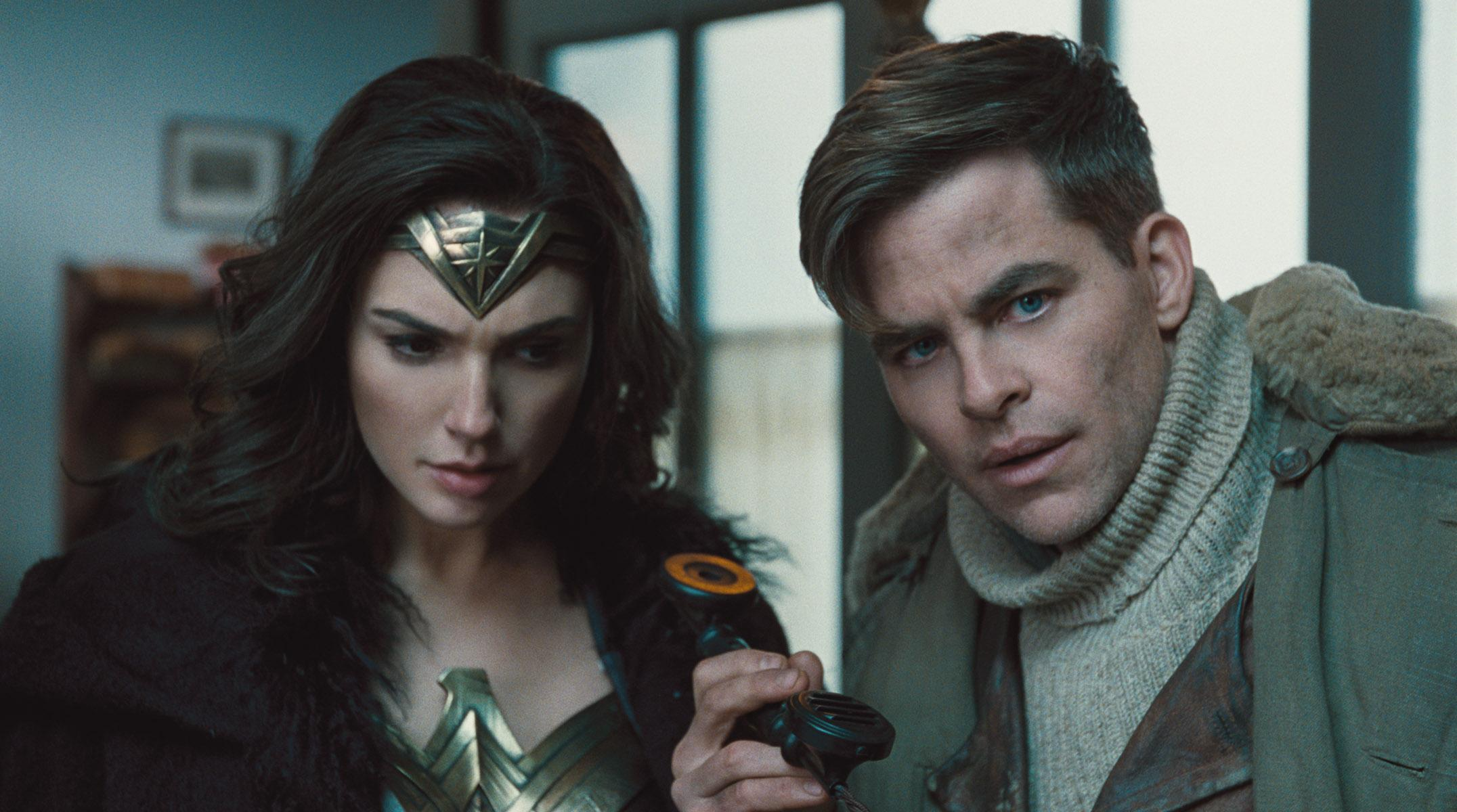 "(L-R) GAL GADOT as Diana and CHRIS PINE as Steve Trevor in the action adventure ""WONDER WOMAN,"" a Warner Bros. Pictures release."