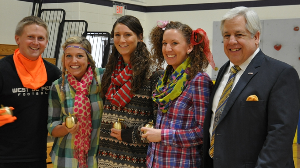 Golden Apple Award recipients Regan Budek, Samantha Sullivan, Kayla Weyenberg and Stacey Debrique of Westwood Elementary School in West De Pere pose with FOX 11's Tom Milbourn, March 5, 2014. (WLUK/Donna Fischer)