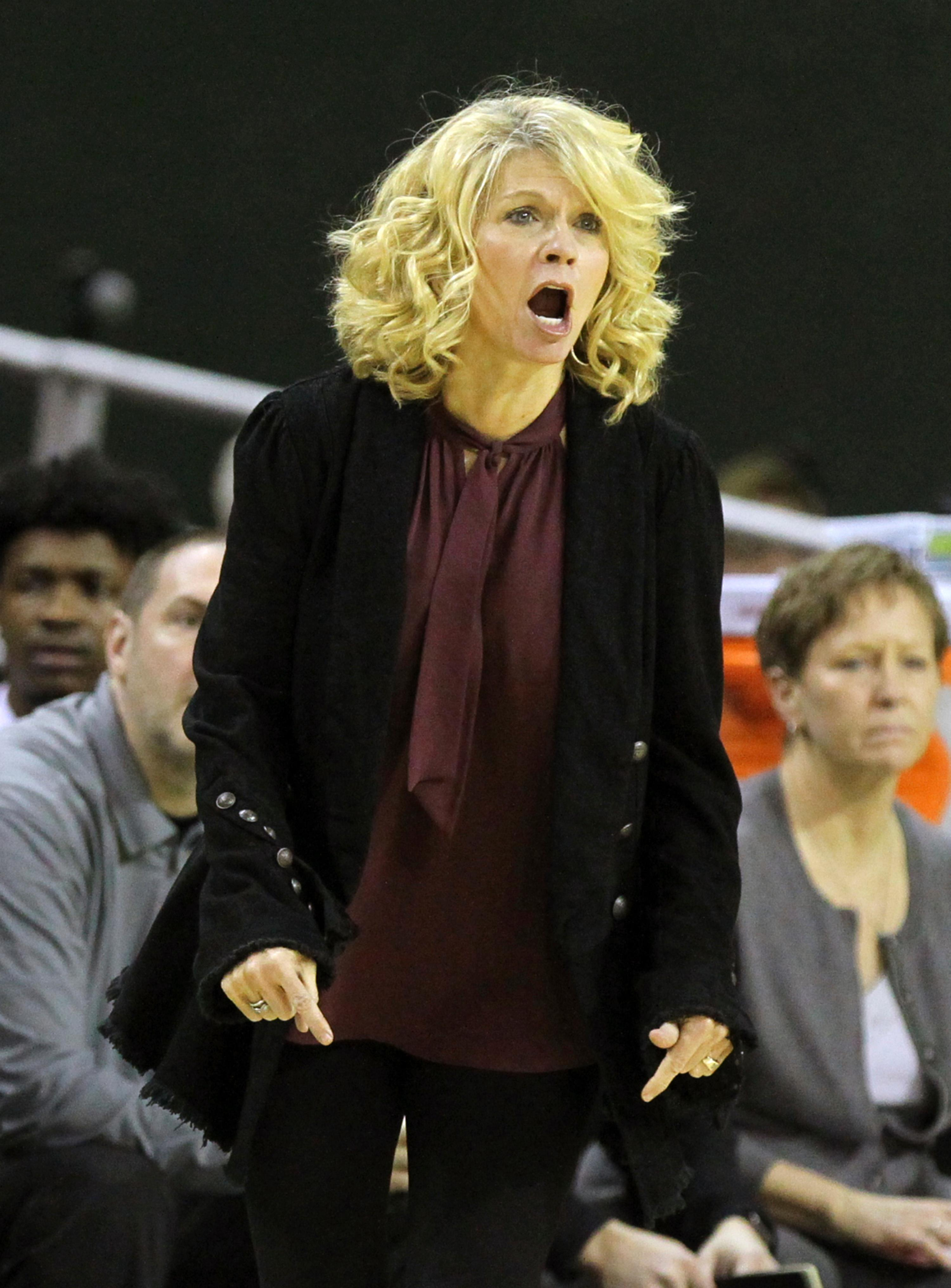 Oklahoma head coach Sherri Coale calls plays to her team against Baylor during the first half of an NCAA college basketball game, Monday, Feb. 5, 2018, in Waco, Texas. (AP Photo/Jerry Larson)