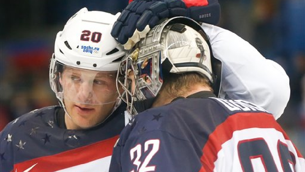 USA defenseman Ryan Suter celebrates Team USA's 5-2 win over the Czech Republic with goaltender Jonathan Quick after the men's quarterfinal hockey game in Shayba Arena at the 2014 Winter Olympics, Wednesday, Feb. 19, 2014, in Sochi, Russia. (AP Photo/Petr David Josek)