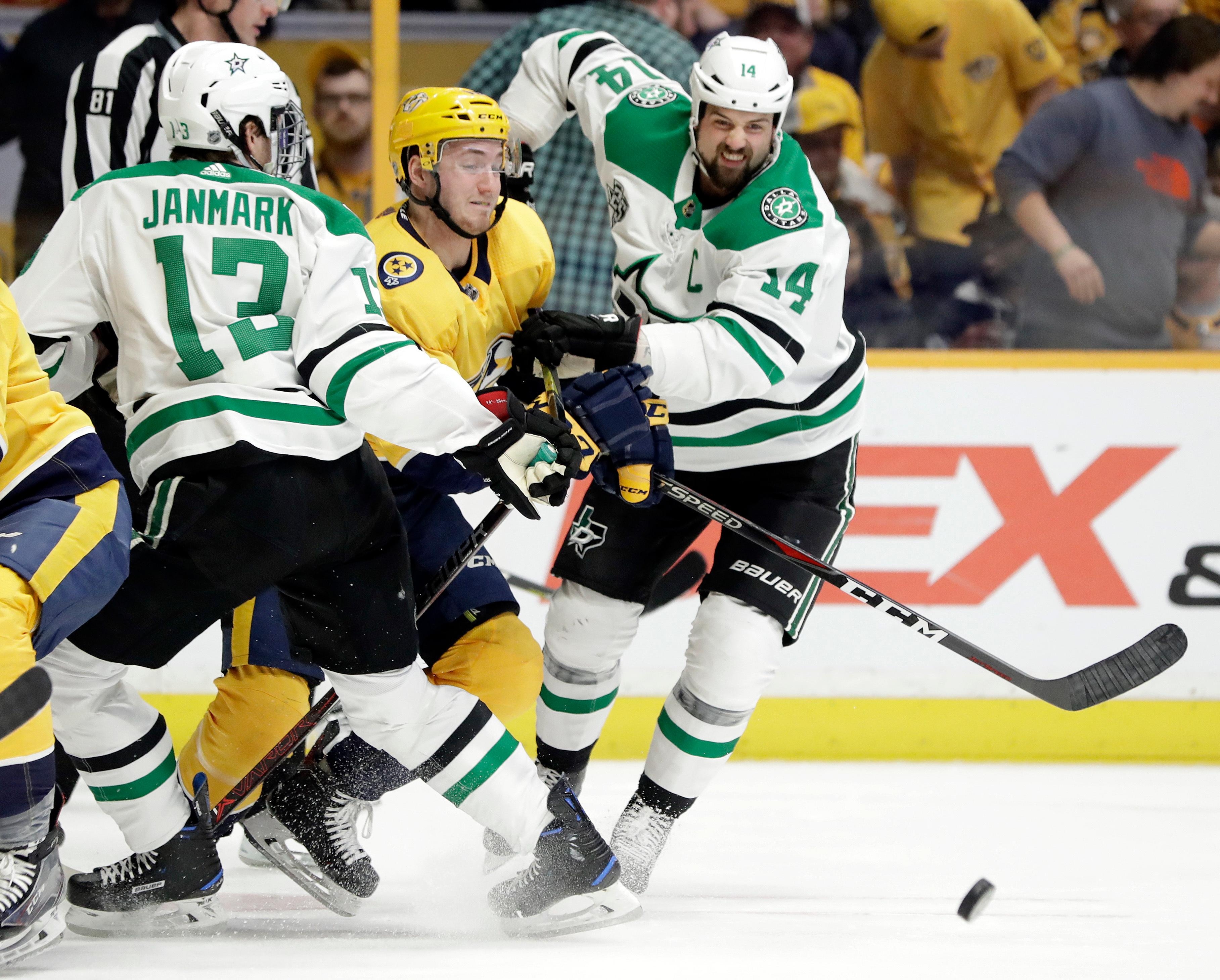 Nashville Predators' Colton Sissons, center, tries to move past Dallas Stars' Mattias Janmark (13), of Sweden, of the Czech Republic, and Jamie Benn (14) in the first period of an NHL hockey game Tuesday, March 6, 2018, in Nashville, Tenn. (AP Photo/Mark Humphrey)