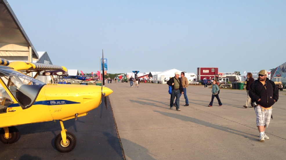 Visitors browse EAA AirVenture, July 28, 2014, in Oshkosh. (WLUK/Pauleen Le)