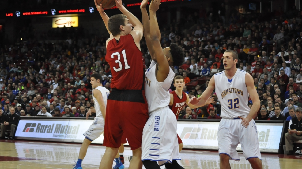 Neenah's Matt Heldt (31) looks to shoot over Germantown's Brian Bearden during their Division 1 state title game last season. (Doug Ritchay/WLUK)