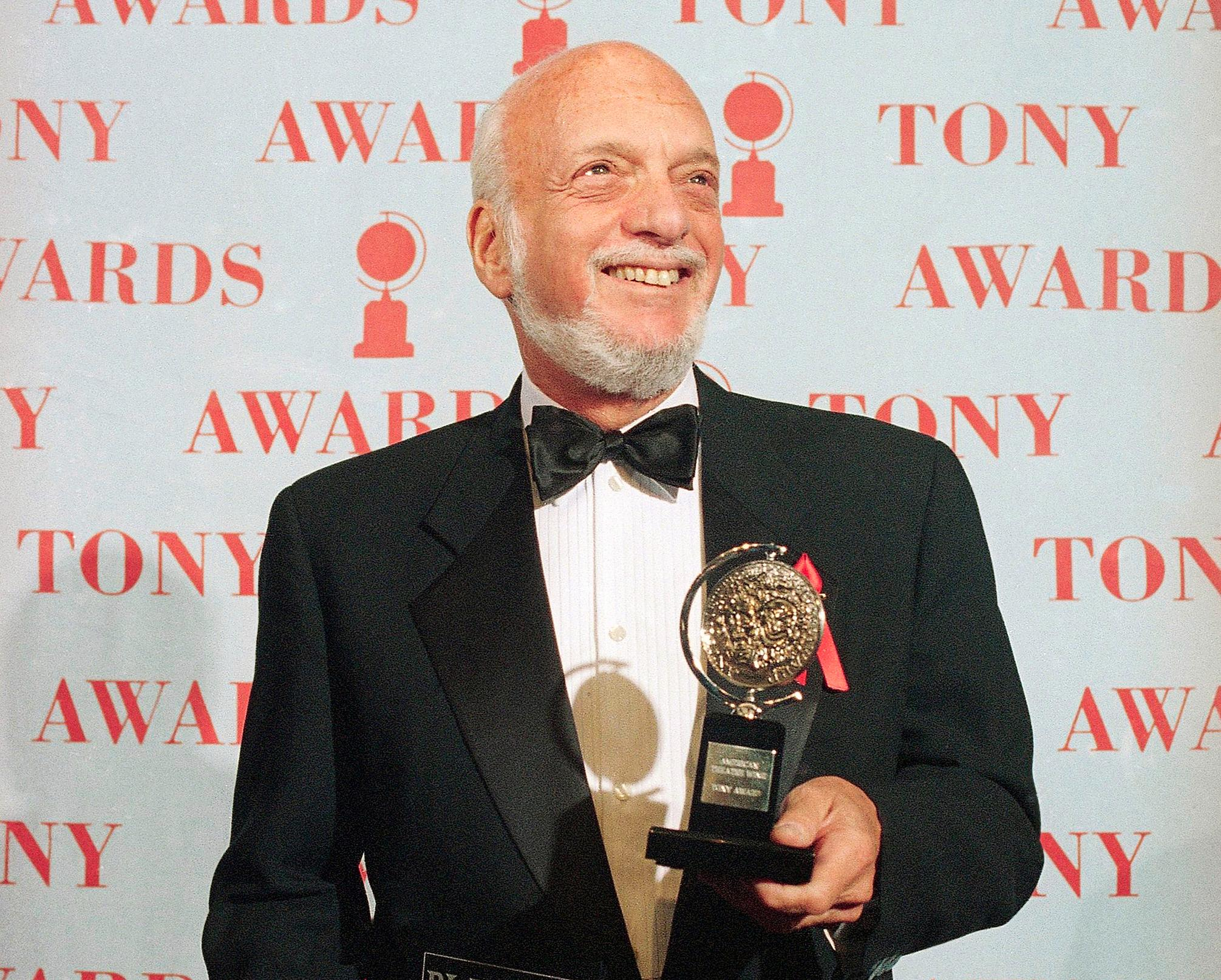 "FILE - In this June 4, 1995 file photo, Harold Prince holds his Tony award for best director in a musical for ""Show Boat,"" at Broadway's Minskoff Theater in New York. .   (AP Photo/Richard Drew, File)"