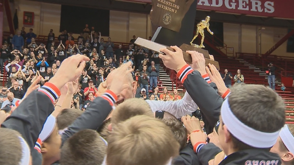 Kaukauna hoists the division one team state wrestling trophy in Madison. (WLUK)