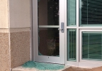 Glass in an exterior door to a library at New London High School is broken, May 20, 2014. (WLUK/Pauleen Le)