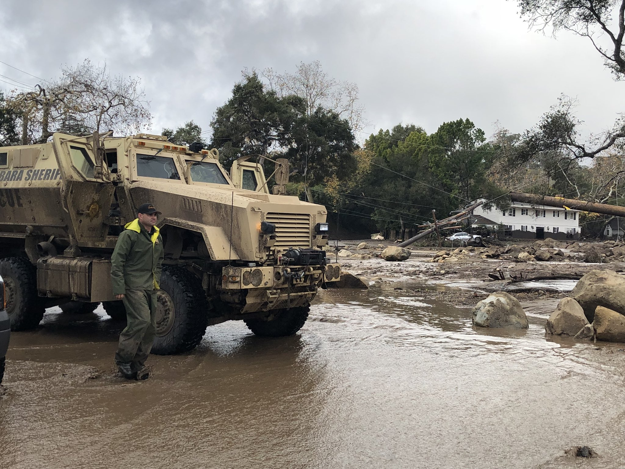 A Santa Barbara County Sheriff's Rescue Vehicle is staged while trying to get past vehicles on Hot Springs Road in Montecito. Deadly mudflow from overnight rain destroyed homes and killed at least 8 people.{ }(Photo & Caption: Mike Eliason, Santa Barbara County Fire Dept.)