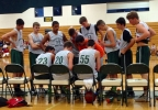 The Ashwaubenon boys basketball team huddles during a timeout during a summer league game. (Doug Ritchay/WLUK)