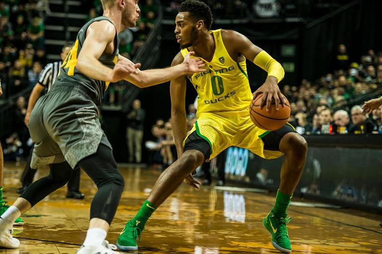 Oregon's Troy Brown Jr. (0) looks for an opening in their matchup with ASU, Thursday at Matthew Knight Arena. Oregon defeated ASU 75-68 to improve their season record to 18-10 (8-7 PAC-12). The Ducks face off against fourteenth ranked Arizona for their final home game of the season at Matthew Knight Arena on Saturday. (Photo by Colin Houck)