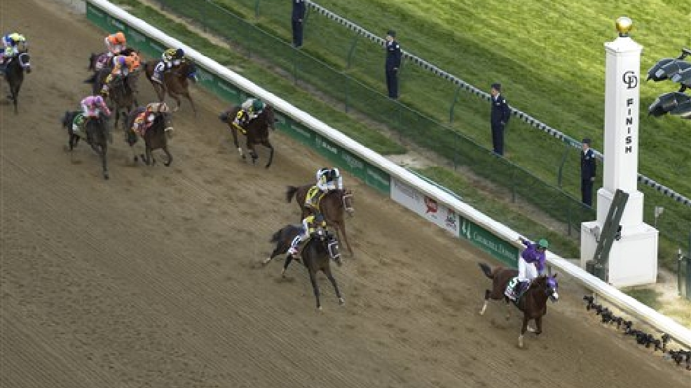 Victor Espinoza rides California Chrome to victory during the 140th running of the Kentucky Derby horse race at Churchill Downs Saturday, May 3, 2014, in Louisville, Ky. (AP Photo/Charlie Riedel)