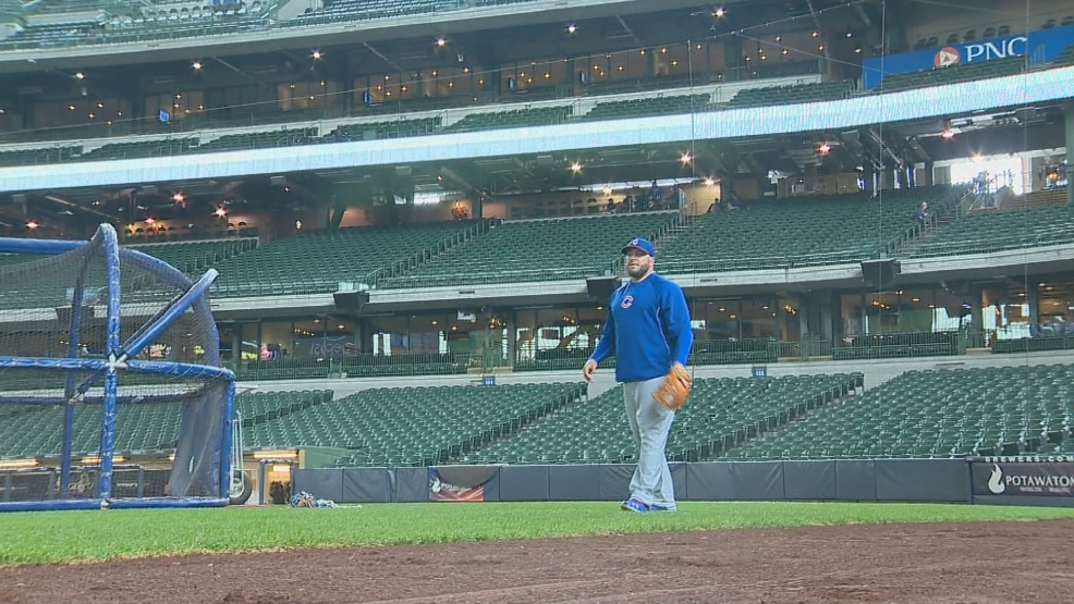 Eric Hinske plays catch prior to a Cubs and Brewers game.