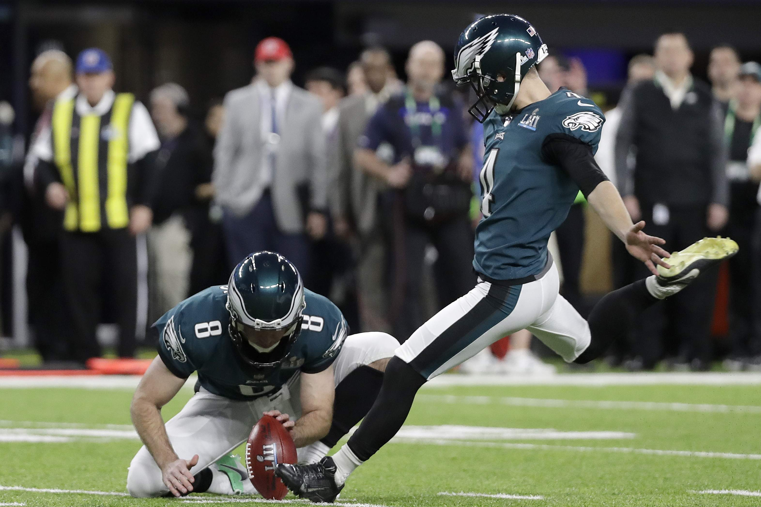 Philadelphia Eagles kicker Jake Elliott, right, kicks a field goal during the first half of the NFL Super Bowl 52 football game against the New England Patriots Sunday, Feb. 4, 2018, in Minneapolis. (AP Photo/Mark Humphrey)