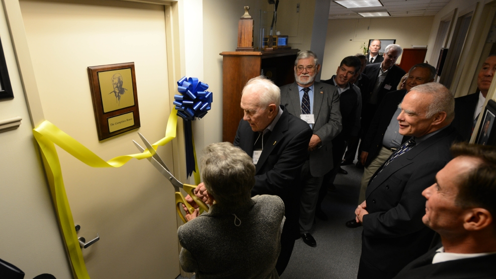 Retired Chief of Information (CHINFO) Rear Adm. Bill Thompson and his wife Zum cut the ribbon to The Gumption Room in the Pentagon offices of the U.S. Navy Chief of Information. The conference room was dedicated to Thompson in honor of his years of service as a naval officer and his role as the first Navy public affairs officer to hold the title of CHINFO. (U.S. Navy photo by Mass Communication Specialist 2nd Class Martin L. Carey/Released)